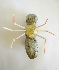 Legs attached to the thorax with tape. Armature for paper mache giant insects.