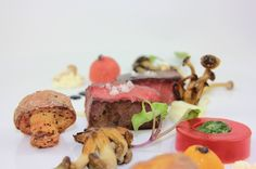 Beef & Mushrooms: souse vide steak, warm tomato gel, reverse spherification of chimichurri, truffle potato, oyster mushroom, beech mushroom, inoki mushroom, olive oil powder, balsamic reduction, baby heirloom tomatoes, black Cyprus sea salt.  A creation by Celsius Cuisine & Catering