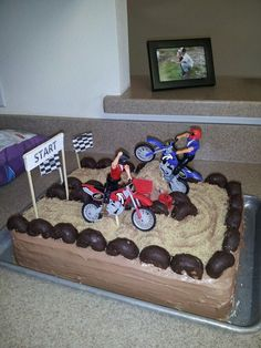 My son's dirt bike birthday cake. Just a plain chocolate cake with chocolate icing!