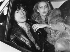Rolling Stones singer Mick Jagger travels in the back seat of a car with his Texan fashion model girl friend Jerry Hall, in Paris. (Photo by Keystone/Getty Images)