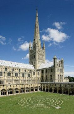 England Travel Inspiration - Norwich Cathedral, cloister and labyrinth - Norwich, England, UK - begun in 1096 and constructed out of flint and mortar and faced with a cream-coloured Caen limestone. A Saxon settlement and two churches were demolished to ma