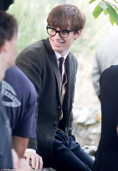 Intellectual: Eddie Redmayne wears thick-rimmed glasses and a brown blazer as he plays physicist Stephen Hawkings :)