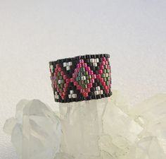 Beaded Peyote Stitch Ring with Sterling silver plated delicas in a native american pattern size 8 by AtelierKarre on Etsy https://www.etsy.com/listing/211340033/beaded-peyote-stitch-ring-with-sterling