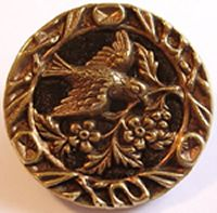 wonderful perfume button. Metallic design on a velvet support. Women would offer one to their lover with a drop of perfume. He would wear it under his collar.