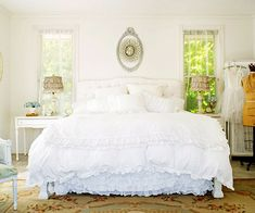 Billowy white bed linens and a handful of ultrafeminine accessories make this bedroom a serene and soothing escape. A collection of vintage-style furnishings create a relaxed and welcoming environment.