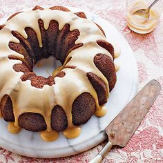 """Spiced Caramel Bundt Cake   Cinnamon, ginger, and nutmeg give this gluten-free cake its signature spiced flavor, and applesauce lends moistness while allowing you to use less oil. A drizzle of golden caramel syrup is the finishing touch, making this the perfect """"ta-da!"""" dessert to serve at your next dinner party or ladies' tea."""