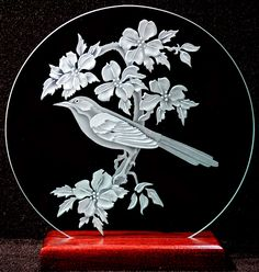Carved Glass Mocking Bird on 9 inch Circle with Handcrafted Base. $48.00, via Etsy.