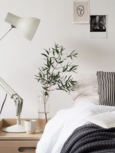 Simple bedside details - Anglepoise lamp, eucalyptus, white bedding. A simple guest bedroom update with Heal's Morten collection