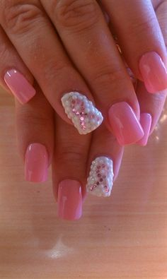 breast cancer awareness nails.  I tried to get something similar to this today.  But because my real nails are so short I ended up only being able to get pink and then glitter on my ring fingers.