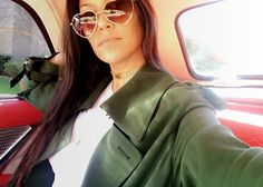 Chauffeur status:Kourtney snapped a selfie in the backseat of a classic sports car, acting as if she was getting the chauffeur treatment from her daughter and niece