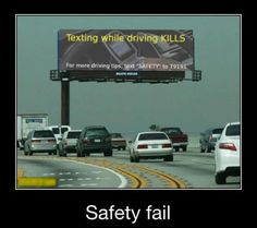 Texting while driving  And Hey look at this huge billboard instead of the road...