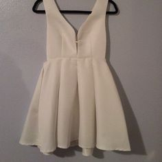 White low front flare dress White low front open dress with open sides. Flare dress. NEVER WORN! Lulu's Dresses Mini