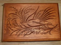 Chip carved dove on lid of wooden jewelry box