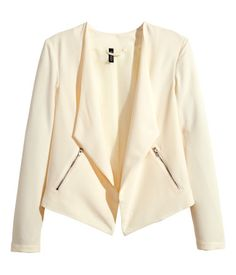 Jacket in woven crêpe fabric. Slightly longer front section, side pockets with visible zip, and no buttons. Lined.