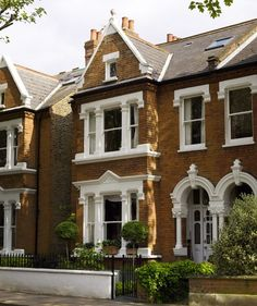 london window boxes | An ironwork fence and gate defines the property.