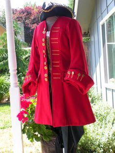 This is a lovely pirate coat. $250.00, via Etsy.
