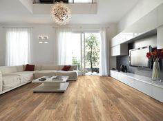 """Style Selections Natural Timber Cinnamon 8""""x48"""" porcelain tile is sold at Lowe's.  The tiles feature rectified edges to allow installers to set the tile with very small grout joints.  It has a rustic natural look, without too much variation."""