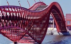 A modern red bridge to the Java island..Amsterdam