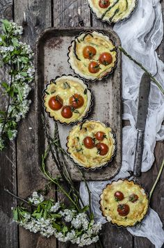 Tarts with feta cheese, cherry tomatoes and asparagus.
