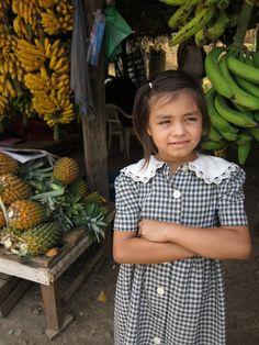 Young girl along the expressway between Tegucigalpa and San Pedro Sula, Honduras.