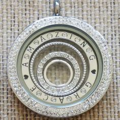 """Shown is our large locket with retired double accent Swarovski face, large window plate with """"Amazing Grace"""" on the front with Swarovski stations in between letters and our nesting bubbles set inside. Locket Bracelet, Origami Owl Jewelry, Living Lockets, Personalized Charms, Jewelry Companies, Amazing Grace, Charm Jewelry, Custom Jewelry, Swarovski"""