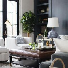 Brown Leather Tufted Ottoman Coffee Table with White Stripe Chairs