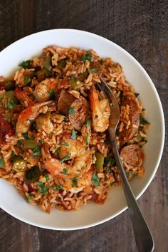 Typically there are two main types of jambalaya, Creole and Cajun. Creole, or red jambalaya, is made with tomatoes along with the meat and vegetables. Cajun jambalaya does not have tomatoes and is more of a brownish color. Creole Recipes, Cajun Recipes, Sausage Recipes, Seafood Recipes, Chicken Recipes, Cooking Recipes, Haitian Recipes, Spicy Sausage, Dishes Recipes