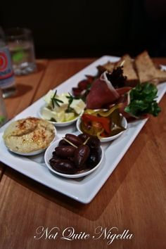 mezze platter [Bistro bar 2020 - Sydney airport] which had olives, hummus, rosemary feta, pickles, prosciutto wrapped salad leaves, fried chorizo and toasted bread. Might try this combo next time friends are over
