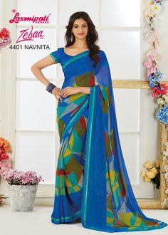 Brighten up your look with this Blue colored Georgette Saree carrying Blue colored Georgette Blouse that takes you through the season in style. Impress everyone with your amazing traditional look. Laxmipati Sarees, Georgette Sarees, Casual Saree, Traditional Looks, Printed Sarees, Sarees Online, Daily Wear, Bridal Collection, Casual Wear