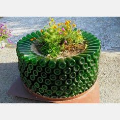 Isn't this planter beautiful? Reduce, reuse!