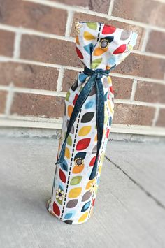 Padded for extra protection, this quick project fits snuggly around the bottle with a ribbon tie. This is a perfect quick and simple way to show off your crafty side with your next gift!