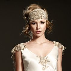 pin up your long hair leaving some pieces down and then add a head band for a 20s feel