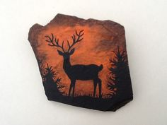 Hand painted rock - Deer silloutte by Phyllis Plassmeyer