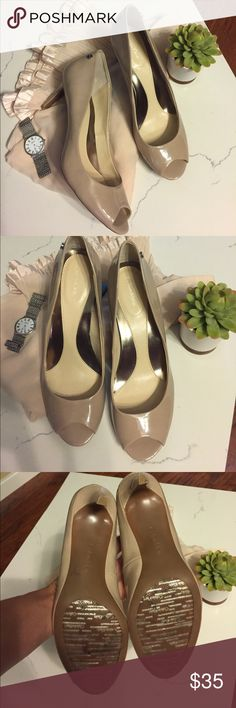 Calvin Klein Kasia Peep-Toe Patent Leather Pumps Classic simple Calvin Klein patent leather peep-toe medium heels in Adobe Beige. Silver CK accent button on outside heel. Cushioned rubber sole for footbed. Great condition. Calvin Klein Shoes Heels