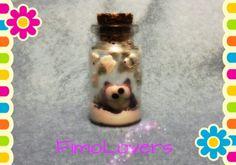 Bottiglietta con mini gufetto portafortuna.