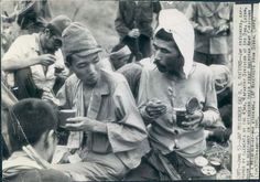 Japanese Prisoners Attack C Rations After Capture. Photo dated Jun 5, 1945.