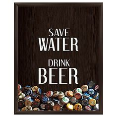 "Save your bottle-caps in this playful and framed graphic wall art. The ""Save Water Drink Wine silk screened shadow box is framed in espresso-colored molding. Great for your bar or den, or it makes the perfect gift for the beer lover in your life."