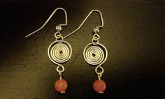 Check out this item in my Etsy shop https://www.etsy.com/listing/462809529/rhodonite-and-spiral-dangle-earrings