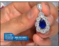 Blue sapphire in a pear shape set with diamonds in a lovely pendant.
