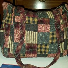 Bella Taylor Patchwork Purse This is a beautiful Bella Taylor Patchwork Purse like new. Multiple colors. Several zippered and open pockets. Zip closure. Great buy! Bella Taylor   Bags Shoulder Bags