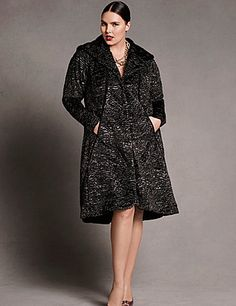 Plush faux Persian lamb coat with oversized shawl collar, grosgrain trim and inset pockets. Quilted lining for extra warmth. Hidden snap closure. lanebryant.com