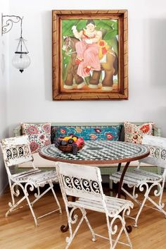 Design finds: Vintage iron outdoor furniture and tile-top tables. Try this at home: Pair outdoor chairs and a tile-top table with an indoor wooden bench and loads of patterned pillows.