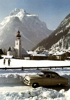 Lofer, Salzburger Land | 1953-1955 Opel Kapitän |  I'm sure this location will be identified soon by one of my German contacts. Cross country skiing, I love it. I just hope these two realize there is a fence ahead. But maybe the Opel is waiting for them.