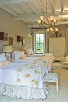 Cathy Kincaid Interiors - love those bedskirts and the little benches at the end of the bed: must rmbr this, so much better than a footboard - footboard doesn't let you hang your feet over end of bed + makes bed harder to make + benches are cute and great for putting socks and shoes on ....