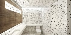 Bathroom Tile Idea - Use The Same Tile On The Floors And The Walls | Small black and white square tiles have been randomly arranged to create a polka dot look on the floors and walls of this bathroom.