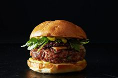 Suzanne Goin's Grilled Pork Burgers. Pork, Applewood Bacon, Chorizo, Manchego cheese, with arugula, aioli and romesco. Yum!