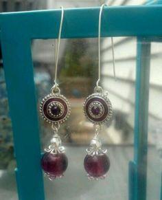 Purple glass beads, enamel connector, silver bead caps.