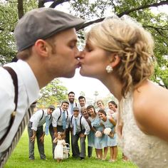 15 Best Wedding Kiss Photos - Love how you can get the whole wedding party in this shot! wedding-ideas