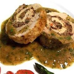 Pork tenderloins are pounded flat, spread with olive tapenade, and blue cheese, then rolled up and roasted. A Dijon-lemon sauce finishes this elegant dish. Your guests will surely be impressed!