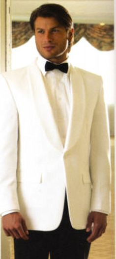 This is an elegantly tailored blazer with self-faced shawl lapel. Sharper Uniforms offers this selection in white and ivory. http://www.sharperuniforms.com/formal-shawl-collar-dinner-jacket.html